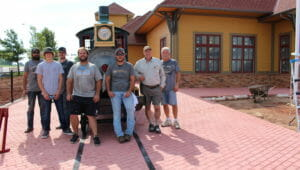 Aug. 2019 - Exhausted but triumphant, the crew poses with the train before installing the final details.